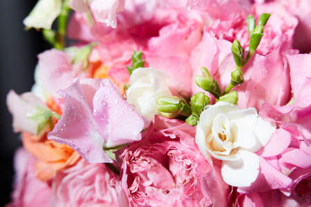 A Bucket of peony flowers with other different flowers close-up Stock Photo