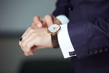 Man's hands with watches and studs close-up