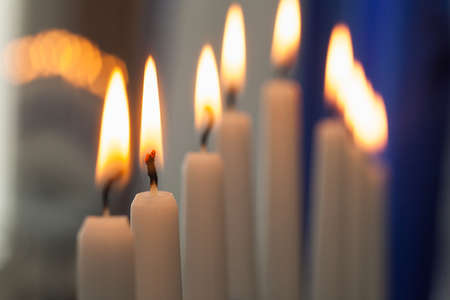 Some candles with romantic fire put one by one in order