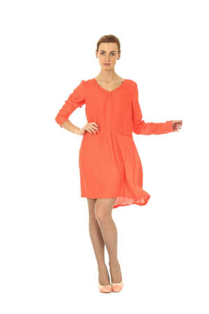 cocktail dress: Fashion model wearing coral cocktail dress