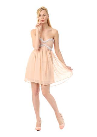 prom dress: Fashion model wearing beige prom dress