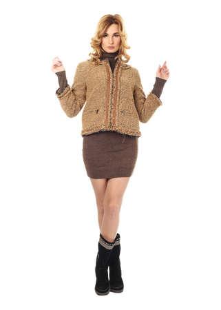 Fashion model wearing brown sweater dress