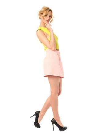 mini skirt: Woman in mini skirt standing in full length