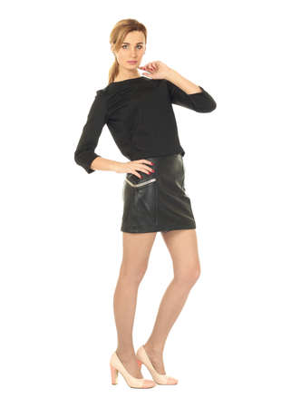 Woman in leather skirt standing in full length
