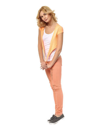 Beautiful young woman in jeans isolated on white background Stock Photo