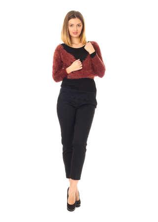 Pretty young girl wearing long black trousers