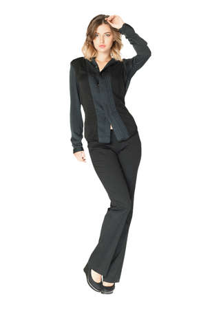 industry trends: Pretty young girl wearing long black trousers