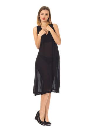 belles jambes: Jeune fille en robe noire isolé sur blanc