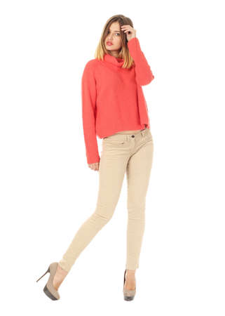 Portrait of stylish young model in beige jeans
