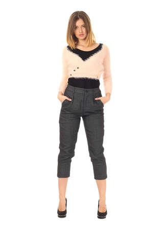 bolero: Pretty young girl wearing long gray trousers Stock Photo