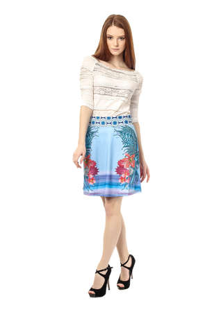 Young fashion girl in skirt posing isolated Stock Photo
