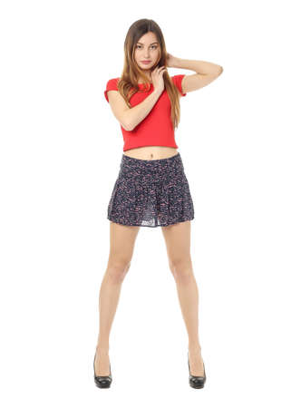 Young girl in skirt posing isolated on white Stock Photo