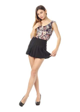 mini jupe: Jeune fille en jupe posant isolé sur blanc Banque d'images
