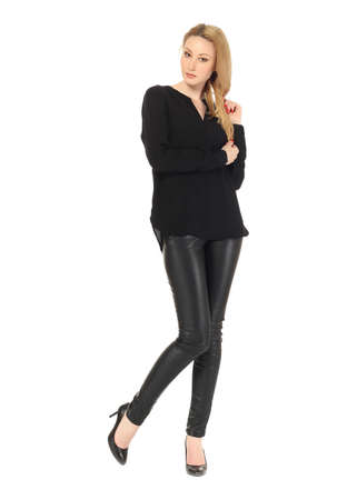 leather pants: Blonde model wearing black leather pants Stock Photo