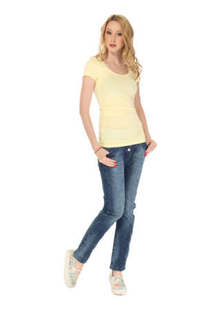 Young sexy blond woman in yellow shirt isolated