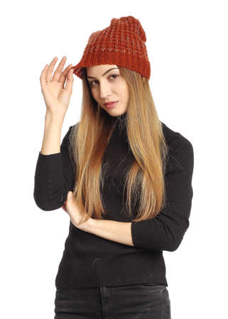 Portrait of woman on white background wearing coral winter hat