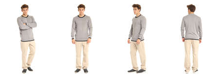 Handsome young man in gray pullover standing