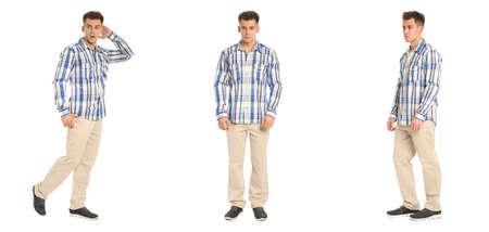 Handsome young man in tartan shirt standing