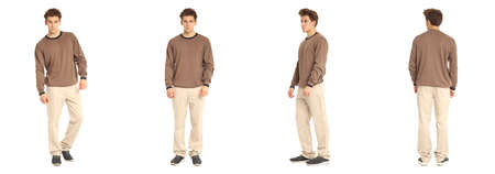 Handsome young man in brown pullover standing Stock Photo