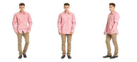 khaki pants: Handsome young man in pink shirt standing