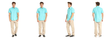 Handsome young man in blue shirt standing Stock Photo