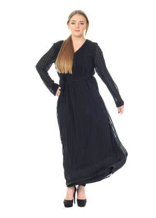 Full length studio shot of a large woman in black dress Stock Photo