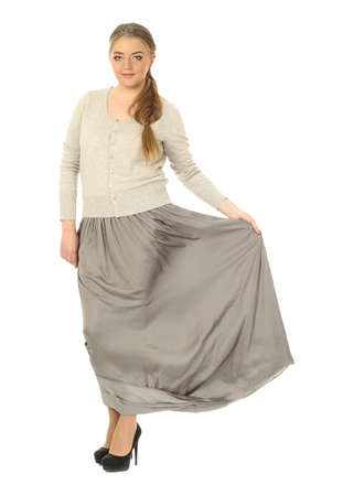 Studio shot of a large woman in gray skirt Stock Photo