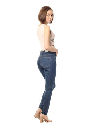 booty: Girl standing in jeans in the studio isolated