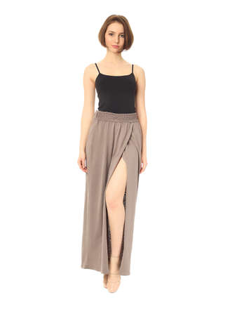 Fashion model dressed in slit beige skirt isolated Stock Photo