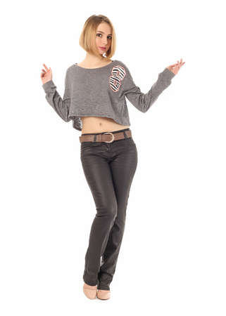 Girl standing in leather pants in studio isolated