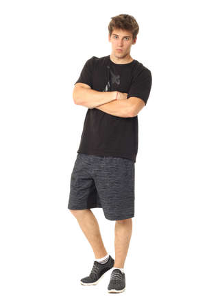 Full length portrait of a fitness man in gray shorts Imagens