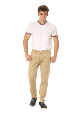 khaki pants: Handsome man in white shirt and brown pants