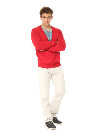 red cardigan: Handsome man in red cardigan and white pants