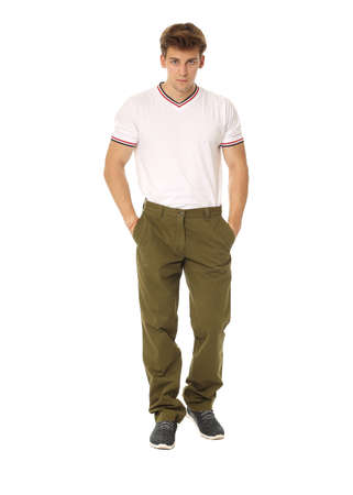 khaki pants: Handsome man in white shirt and khaki pants Stock Photo