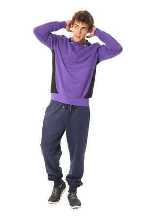 Young male in the violet sportswear isolated Stock Photo