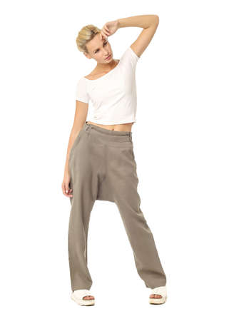Portrait of fashionable young woman dressed in galife pants