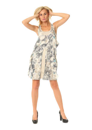 Full length of flirtatious woman in dress isolated