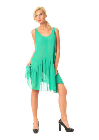Full length of flirtatious woman in green dress isolated Stock Photo