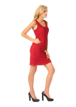 Portrait of flirtatious woman in red cocktail dress isolated