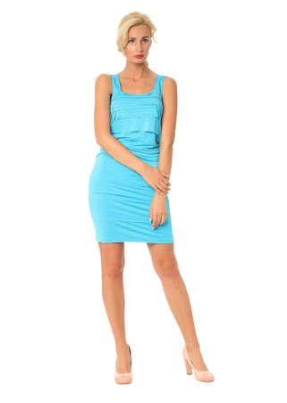 Portrait of flirtatious woman in short blue dress isolated