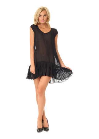 Celá délka koketní ženy v izolovaných průhledných šatech