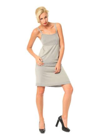 Full length of flirtatious woman in gray dress isolated Stock Photo