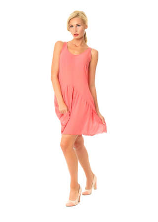 Full length of flirtatious woman in pink dress isolated Stock Photo