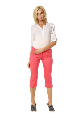 Beautiful sexual woman blonde pose in pink breeches