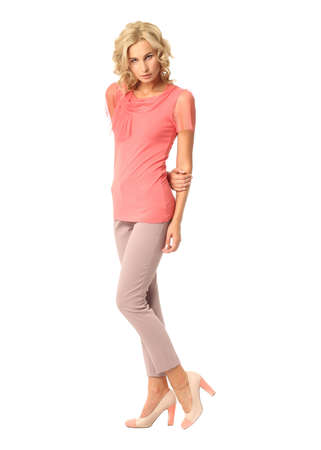 Blond fashion model girl stand in pink trousers Stock Photo