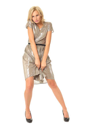 Full length of flirtatious woman in disco dress isolated