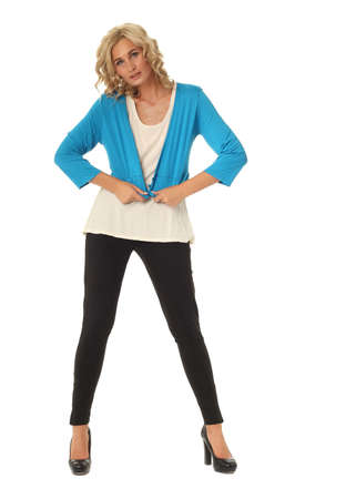 Portrait of young beautiful blonde in blue bolero coat