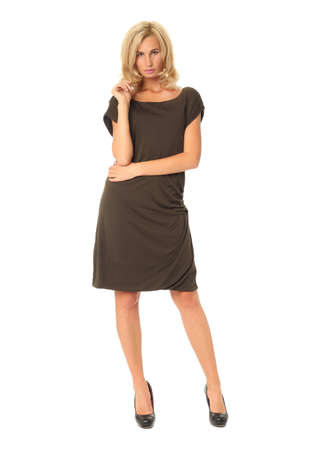 Full length of flirtatious woman in brown dress isolated