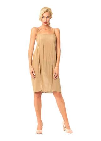 Full length of flirtatious woman in khaki dress isolated
