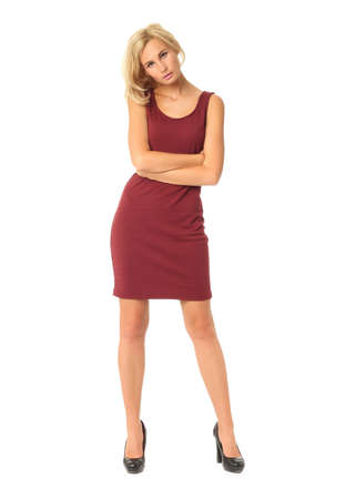 Portrait of flirtatious woman in short burgundy dress isolated